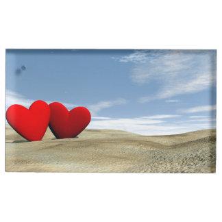 Deux coeurs sur la plage - 3D rendent Porte-photos