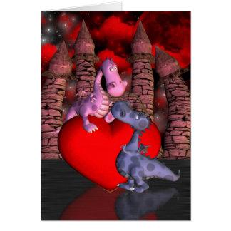 deux dragons mignons, un sur un coeur un carte de vœux