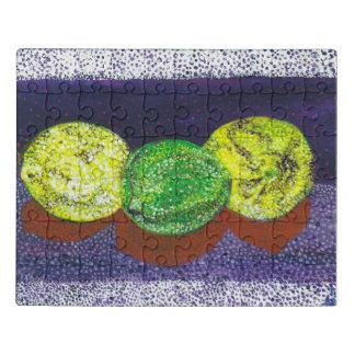 Deux puzzles de citrons et d'un acrylique de chaux