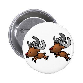 Deux rennes/caribous mignons de bande dessinée badge