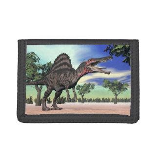Dinosaure de Spinosaurus dans le désert - 3D