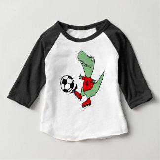 Dinosaure drôle de T-rex jouant au football T-shirt Pour Bébé