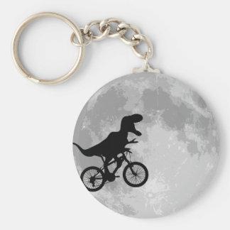 Dinosaure sur un vélo en ciel avec la lune porte-clefs