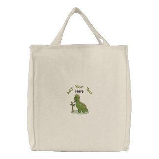 Dinosaure vert sac fourre-tout brodé