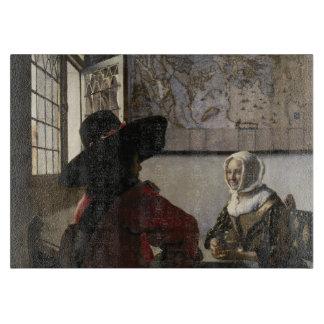 Dirigeant et fille riante par Johannes Vermeer Planche À Trancher