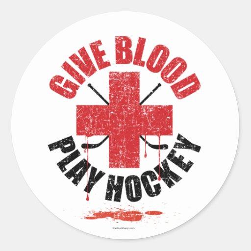 Donnez l'hockey v1 de jeu de sang adhésif rond