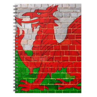 Drapeau du Pays de Galles sur un mur de briques Carnet