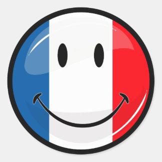 Drapeau français de sourire sticker rond