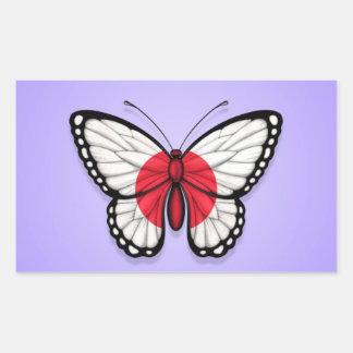 Drapeau japonais de papillon sur le pourpre autocollant en rectangle