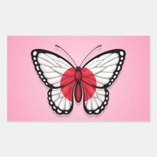 Drapeau japonais de papillon sur le rose sticker rectangulaire