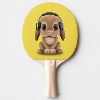 Écouteurs de port de lapin mignon de bébé raquette tennis de table