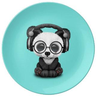 Écouteurs de port de panda mignon de bébé assiette en porcelaine