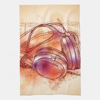 Écouteurs sur un arrière - plan et des notes d'aqu serviette éponge