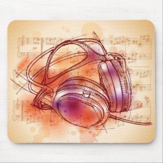 Écouteurs sur un arrière - plan et des notes d'aqu tapis de souris