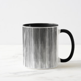 Égouttements noirs et gris de peinture sur le tasse