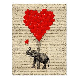 Éléphant et ballons en forme de coeur