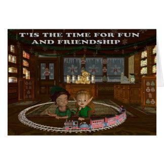 Elfes jouant avec un train carte de vœux