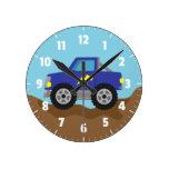 Emballant le camion de monstre bleu, pour la pièce horloge ronde