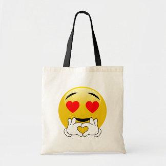 Emoji avec des yeux et des mains de coeur tote bag