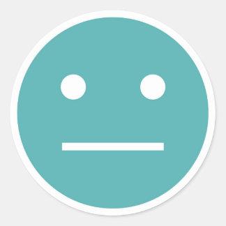 Emoji vide turquoise de visage sticker rond