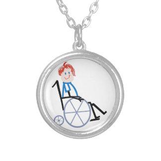 Enfant de fauteuil roulant de bâton pendentif rond