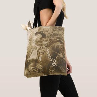 Enfant occidental vintage de cow-girl sur le sac