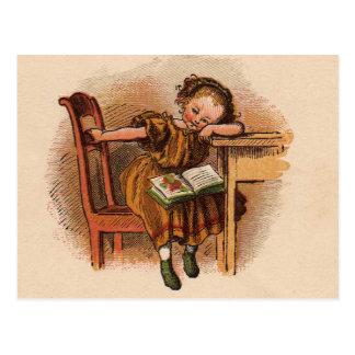 Enfant victorien avec le livre carte postale