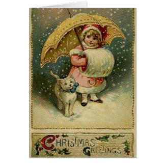 Enfant victorien et chat dans la carte de Noël de