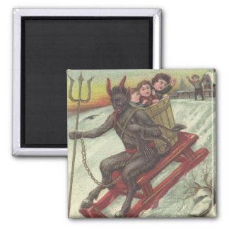 Enfants de kidnapping de Krampus sur la fourche de Aimant