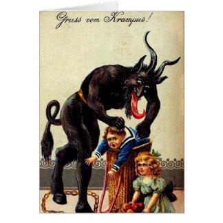 Enfants de Krampus dans la carte de voeux de Noël
