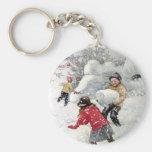 enfants jouant dans la neige porte-clés