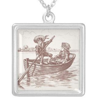 Enfants victoriens dans le bateau à rames collier