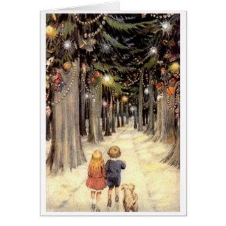 Enfants vintages de carte de Noël sur la route
