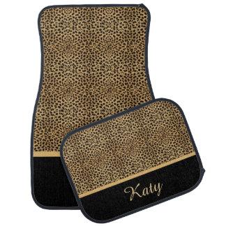 Ensemble de monogramme d'or d'empreinte de léopard tapis de voiture