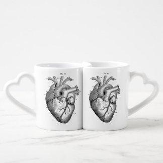 Ensemble vintage de la tasse de coeur des couples