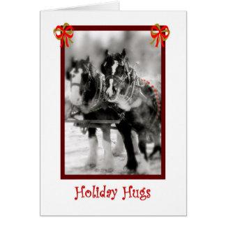 Équipe de cheval de trait, étreintes de vacances carte de vœux
