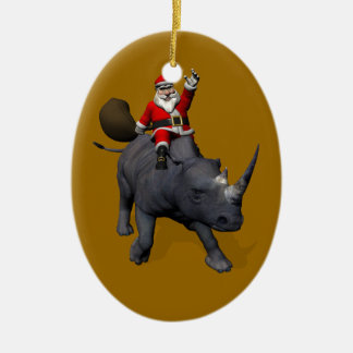 Équitation du père noël sur le rhinocéros ornement ovale en céramique
