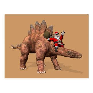 Équitation du père noël sur le Stegosaurus Carte Postale