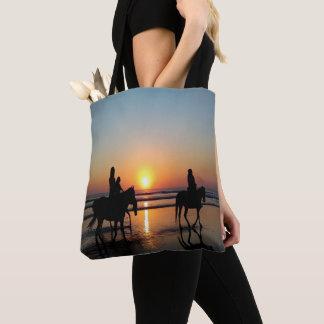 Équitation sur la plage au sac fourre-tout à