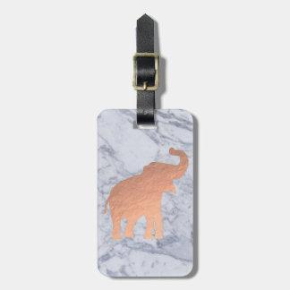 Étiquette À Bagage conception rose d'éléphant d'or sur le marbre