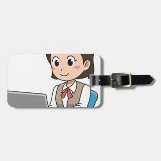 Étiquette À Bagage Femme sur l'ordinateur portable