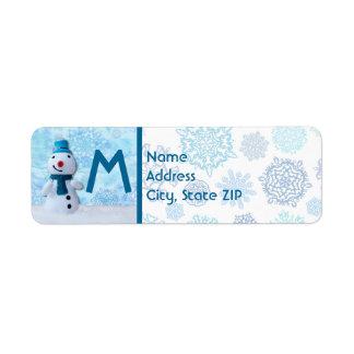 Étiquette Bonhomme de neige de sourire avec l'écharpe bleue