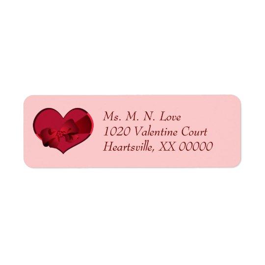 Étiquette Coeur avec l'arc rouge Valentine