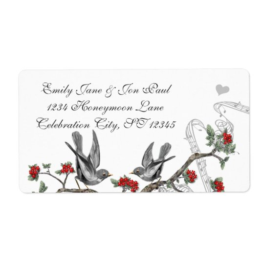 Étiquette de branche fleurissant rouge d'oiseaux