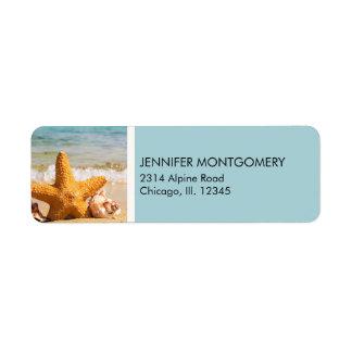 Étiquette Étoiles de mer et coquillages sur la plage