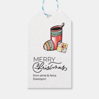 Étiquette faite sur commande de Noël avec des bas