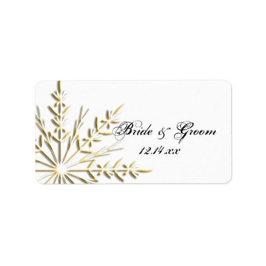 Étiquette Flocon de neige d'or sur l'étiquette blanche de
