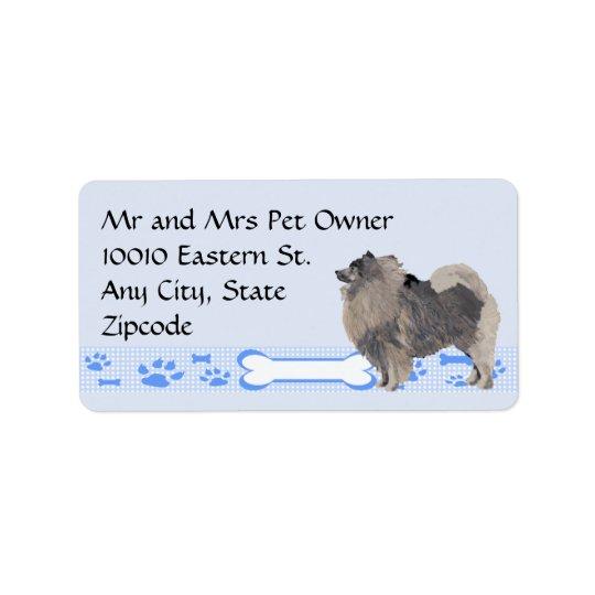 Étiquette Keeshond sur le guingan bleu