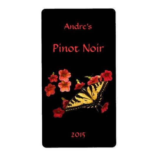 Étiquette Machaon de tigre sur l'étiquette floral rouge de