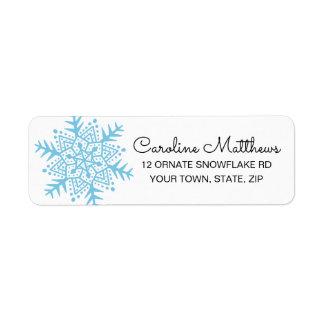 Étiquette Noël bleu-clair de flocon de neige d'art populaire
